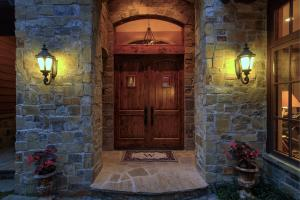 Knotty Alder custom, high clearance doors surrounded by Montana hand picked stone. You know you're about to enter into radiance from the moment you pull in the driveway.