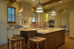 European-style Kitchen - A Chef's Dream! So many high-end features, with Tuscan accents Montrachet Medallion Backsplace, Tapley's custom cabinets, Granite counters, Stainless appliances and so much more.