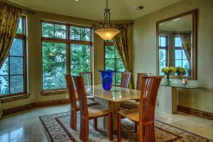 Big bay window with lake views adorn this abundant light filled dining room. Travertine floors, wood wrapped windows.