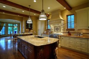 Beautiful breakfast bar/island, Tapley custom cabinets w/pull-out drawers, and walk-in pantry