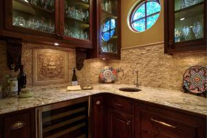 Granite Counters, wine refrigerator, pull-out cabinets, 2nd dishwasher, & bar sink...beautiful stone and granite!