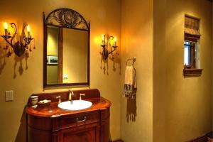 Rojo red marble floor, custom English cherry burl vanity w/gold faucets, and raised ADA Toto toilet