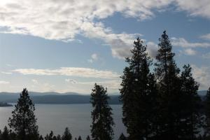 Amazing views year-round of stunning Lake Coeur d Alene. You're pearched in the perfect viewing spot to see the early morning sunrise over the mountains and water, enjoy the day and your surroundings. This view is the backdrop for your beautiful home.