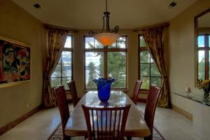 Friends and family will love all the lake views out every window of this special dining room