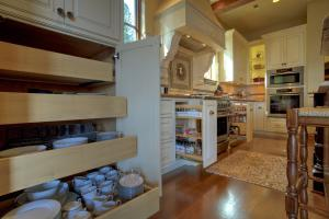 From dish pullouts to spice racks, this kitchen is designed with efficiency and beauty for the chefs in your life!