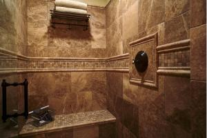 Walk-in Tile Shower w/bench, ADA Toto toilet, and vanity from India w/marble counters & backsplash