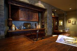 18th Century Tudor bar from Belgium, copper sink, plenty of cabinets, and Subzero bar refrigerator with ice-maker - it will be the center of conversation and you enjoy with friends and family