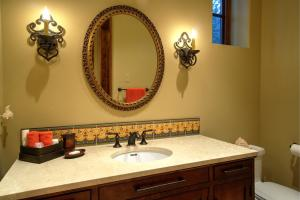 Walk-in shower, raised ADA Toto toilet and Marble counter vanity