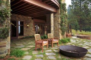 Italian Tuscan inspired patio and firepit with views of the lake, the hot tub for those star filled nights relaxing. Hand pulled Montana Quarry stone used for patio & exterior