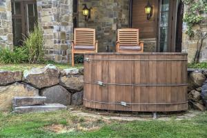 Wooden wine barrel hot tub w/jets... the wine theme surrounded by grapevines and stone, relax away!