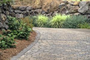 Lush landscaping and incredible paver stone driveway