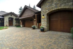 Attached 3 car oversized garage. 3rd Bay is a stone Carriage-style garage with 10' door for boat or camper