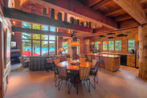 Big Timber beams, floor to ceiling windows to let in the lake views and sun, open floor plan, over 4500 SF, 5 Bedrooms, 4 Bathrooms, 2 DOCKS, 1 large Boat Barn SHOP, 1 hot tub, sleeps 16 ! Adjacent 10 acres available too, could be horse property and so much more. WOW!