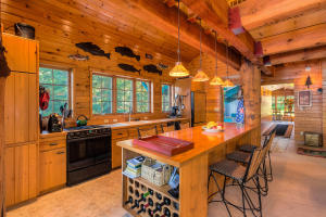 Everyone ends up in this great entertaining kitchen! Boasting a center island bar, lots of storage spaces with pull out drawers in the pantry, wine storage spaces, Bosch Dishwasher, paneled Refrigerator/freezer and solid log beams anchoring the room-perfect lake living.