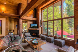 Art and Nature are the backdrops of your beautiful home and life. Gas and Wood burning fireplace with the big two story windows and lake views fit perfectly with the log beam design