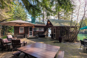 Electrical and plumbing and kitchen appliances are new, but the original charm of this lake cabin is what makes it. Restored to it's glory in 2013 it is THE place to be, sleeps 6 with full bath, kitchen, wood fireplace and sleeping porches! The cutest cabin you'll ever see.