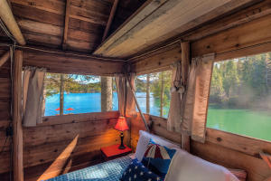 This private screened sleeping cabin is quintessential lakeside living! People will fight over who gets this bedroom!