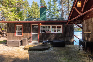 Super cute, restored to it's glory with full kitchen, full bath, sleeping bedroom, porches, swim dock, laundry room and lake views. This is quintessential lake living!