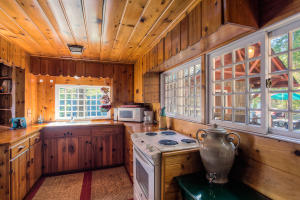 Pine Tongue and Groove ceilings and walls adorn this super cute totally restored cabin. With new appliances, new wiring and plumbing, the charm every guest will love.