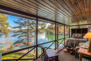 Sleep right at the waters edge in the chic sleeping cabin porch with full screens. You'll have to draw straws to get this special sleeping porch