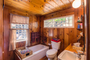 The cabin has a Tub and the HOT/COLD Shower is out on the Patio by the Docks - perfect for summer time showers!