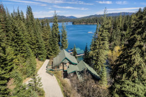 Beautifully designed by RG Nelson to perfection this main lake house has all the touches of a Lake Cabin with all the luxury conveniences, right on the shores of Hayden Lake