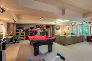 This is the lower level rec bonus room with it's own entry, kitchenette, 4 bunk beds, office area and exercise area - multifunctional space, separate entrance.