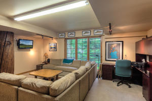 Built in desk area and living space in the multifunctional Bonus Room