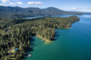 Protected Bay with beach on Stunning Hayden Lake - a true natural glacier lake - only 10 minutes by boat to the Hayden Lake Marina or country club