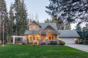 Rare location on the corner of Easy St and Hayden Avenue with beautiful Hayden Lake views, lush landscaping, and easy indoor and outdoor living