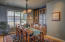 Spacious area for fine dining with built-in china cabinet