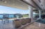 Glass walls retract to open the living space to the decks and views.