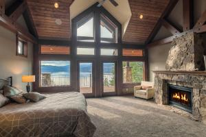 A spa retreat setting...get away from it all in this stunning master bedroom with deck, and full en-suite luxury bath, stone fireplace, tongue and groove ceiling and views of magical Coeur d Alene Lake