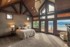 On the main level, master suite is a complete suite with doors to the deck and the lake views. Sitting room, fireplace and large bath ensuite! You can live in this room!