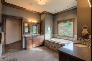 Granite, tile, Toto toilet, his and her vanity sinks, walk in closet, views and so much more!