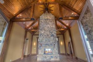 Dramatic floor to ceiling stone fireplace, high ceiling with fans - a great room to enjoy with friends and families