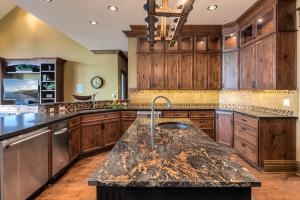 Gorgeous fixtures and faucets , stainless appliances, custom tiles and the beauty of solid granite