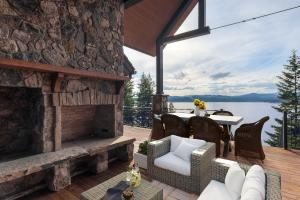 Bask in the sun and views on your deck with stone fireplace and outdoor decking galore
