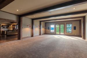 Lower level boasts a full kitchen, theatre space, rec room space, wine cellar and 2 more bedrooms