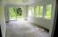 Daylight basement bedroom w/ sliding glass door