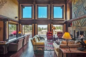 Wall of windows with great views, stone fireplace floor-to-vaulted ceilings - relax in style
