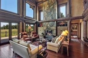 All natural materials including cross-cut fir floors and stone fireplace with copper inlaid bricks.
