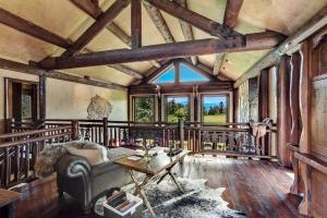 Hand-crafted solid wood throughout with mountain views and access to the sun deck