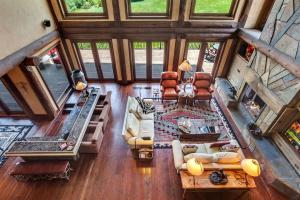 Cozy conversation areas amid the many custom features. Furnished with incredible crafted and Custom leather sofas, recliners, tables, and more..