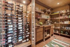 Directly off the kitchen this will be your best pantry ever with wine cellar storage for easy access