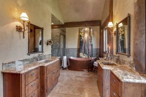 Your own spa daily! Solid copper, jetted tub and Stone shower surround with granite inlay.