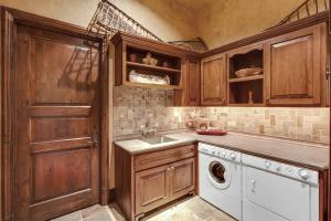 Slate flooring, stone countertops and backsplash, custom cabinets by Robinette - so functional