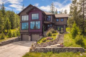 Magnificently designed open entry and floorpan with mountain and golf views.