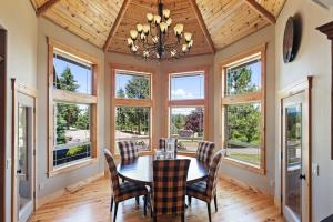 Stunning tongue and groove ceiling, beautiful bay windows, elegant chandelier, outdoor access