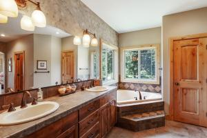 Dual sinks, jetted tub, STEAMIST rain/steam shower, his and her walk in closets